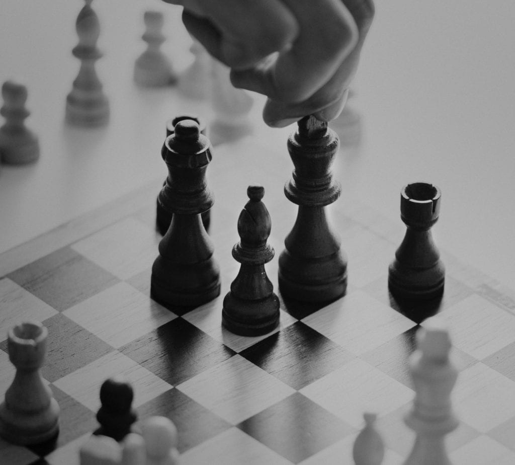 Picture of chess board with hand moving King