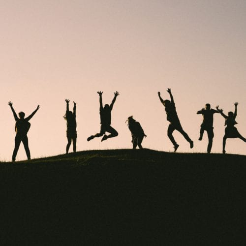 Picture of people in silhouette jumping