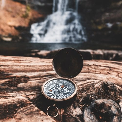 Picture of navigation compass and waterfall