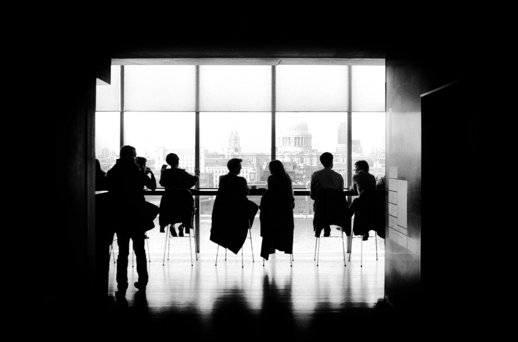 Silhouettes of people in a meeting room on modern office with views of St Pauls