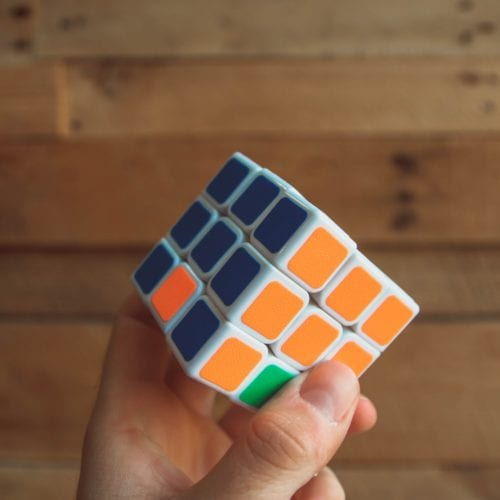 Person holding a Rubik Cube