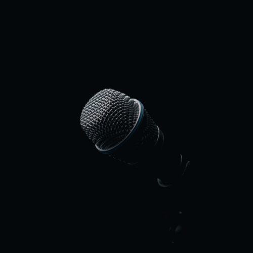 Microphone against a black background