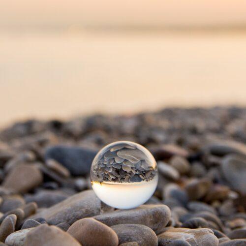 Crystal ball on a stony beach